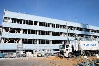 震災発生当時のまま手付かずになっている旧事務本館=福島第1原発で2016年2月12日午後0時22分、森田剛史撮影