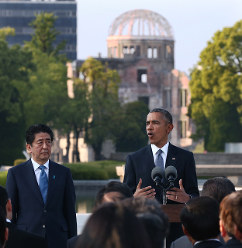 U.S. President Barack Obama delivers a speech at Hiroshima Peace Memorial Park in the city's Naka Ward on May 27, 2016, as Prime Minister Shinzo Abe listens. (Pool photo)