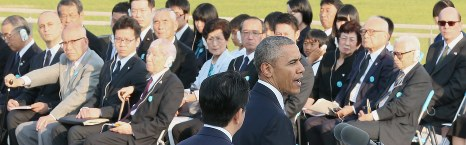 U.S. President Barack Obama speaks at Hiroshima Peace Memorial Park in Hiroshima's Naka Ward as hibakusha in the audience listen, on May 27, 2016. (Pool)