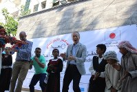 Japanese Ambassador for Palestinian Affairs Takeshi Okubo, fourth from right, dances with children in Gaza on Aug. 17, 2016. (Mainichi)
