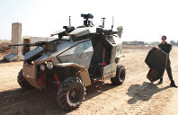 In this November 2013 file photo, an Israel Defense Forces Guardium semi-autonomous vehicle is seen at an IDF base in southern Israel. (Mainichi)