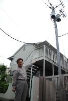 「マイ電柱があるとないとでは全然違う」と語る吉原さん=東京都武蔵野市で