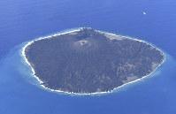 Nishinoshima Island, a new volcanic island in the Ogasawara island chain about 1,000 kilometers south of Tokyo, is seen from the Mainichi Shimbun aircraft