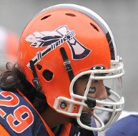 A member of the Hosei University American football club is seen in a helmet emblazoned with the team's logo, a native North American tomahawk ax. The team has announced it will drop the logo and change its name to