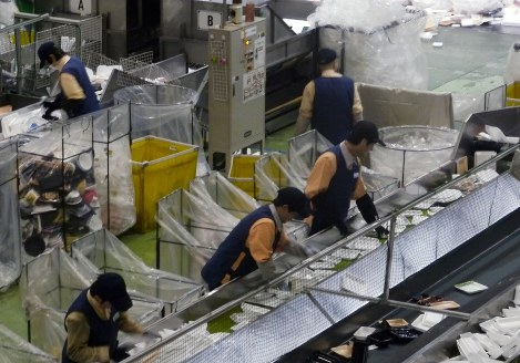 Disabled employees remove non-recyclable trays at FP Corp.'s Kanto recycling plant, in Yachiyo, Ibaraki Prefecture. (Mainichi)