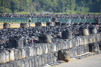 Black bags containing radioactively contaminated soil are seen piled up at a temporary storage site in Minamisoma, Fukushima Prefecture, in this June 2016 file photo. (Mainichi)