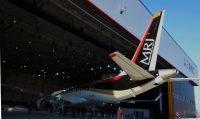 初公開された国産ジェット旅客機MRJの尾部=2014年10月18日、高橋昌紀撮影
