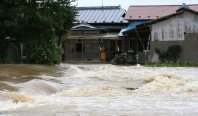 The Miyagi Prefecture town of Taiwa is seen on the morning of Sept. 11, 2015, after the Yoshida River overflowed, flooding homes and rice fields. (Mainichi)