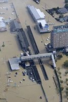 The Kanto Railway's Mitsukaido Station is seen flooded in Joso, Ibaraki Prefecture, on Sept. 11, 2015, a day after the Kinugawa River burst its banks, inundating the area. (Mainichi)