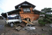 A badly damaged home is seen after flooding in Joso, Ibaraki Prefecture, on the morning of Sept. 11, 2015. (Mainichi)
