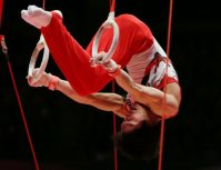 Kohei Uchimura performs on the rings during the men's individual all-around final at the World Gymnastics Championships in Glasgow, Scotland, on Oct. 30, 2015. (Mainichi)