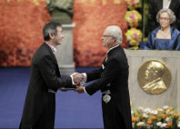 Takaaki Kajita, left, receives the medal and award certificate for the Nobel Prize in Physics from King Carl XVI Gustaf of Sweden at the Nobel Prize Award Ceremony in Stockholm, on Dec. 10, 2015. (Pool photo)