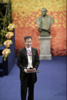 Takaaki Kajita is seen holding his medal and award certificate for the Nobel Prize in Physics at the Nobel Prize Award Ceremony in Stockholm, on Dec. 10, 2015. (Pool photo)