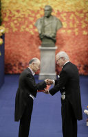 Satoshi Omura, left, receives the medal and award certificate for the Nobel Prize in Physiology and Medicine from King Carl XVI Gustaf of Sweden at the Nobel Prize Award Ceremony in Stockholm, on Dec. 10, 2015. (Pool photo)