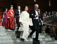 Michiko Kajita, front, the wife of Nobel Prize in Physics laureate Takaaki Kajita, is escorted by King Carl XVI Gustaf of Sweden into the banquet at the Stockholm city hall after the Nobel Prize Award Ceremony, on Dec. 10, 2015. (Pool photo)
