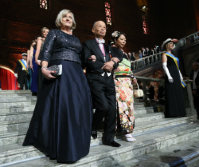 Satoshi Omura, center, enters the Stockholm city hall after the Nobel Prize Award Ceremony, with his daughter Ikuyo, right, and Ulla Lofven, left, Swedish politician and wife of Swedish Prime Minister Stefan Lofven, on Dec. 10, 2015. (Pool photo)