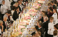 Satoshi Omura, front left, and Takaaki Kajita, upper right, are seen at the banquet for the Nobel Prize Award Ceremony at the Stockholm city hall, on Dec. 10, 2015. (Pool photo)