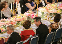 Takaaki Kajita, second from right, talks with Sweden's Queen Silvia during the banquet for the Nobel Prize Award Ceremony at the Stockholm city hall, on Dec. 10, 2015. (Pool photo)