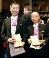 2015 Nobel Prize in physics laureate Takaaki Kajita, left, and Satoshi Omura, winner of the 2015 Nobel Prize in Physiology and Medicine, are seen with their medals and award certificates after the Nobel Prize Award Ceremony in Stockholm, on Dec. 10, 2015. (Pool photo)