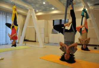 'aerial yoga' enthusiasts stretch their way to health in