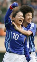 Homare Sawa, left, celebrates after scoring the first goal in a qualifying match between Japan and Mexico for the Women's World Cup, while being congratulated by Eriko Arakawa. (Mainichi)