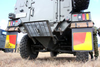 The back of one of the Ground Self-Defense Force's new transport vehicles, with a V-shaped bottom to deflect the force of bomb blasts, is seen at the Somagahara training grounds in Shinto, Gunma Prefecture, on Dec. 17, 2015. (Mainichi)