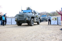 The Ground Self-Defense Force's new transport vehicles are seen in a drill simulating a trip from a Japanese embassy in a foreign country, at the Somagahara training grounds in Shinto, Gunma Prefecture, on Dec. 17, 2015. (Mainichi)