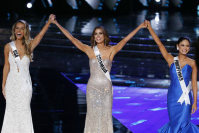 Miss USA Olivia Jordan, Miss Colombia Ariadna Gutierrez, and Miss Philippines Pia Alonzo Wurtzbach, from left, react as they make the final three category at the Miss Universe pageant on Dec. 20, 2015, in Las Vegas. (AP Photo/John Locher)