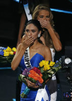 Miss Philippines Pia Alonzo Wurtzbach, front, reacts after she was announced as the new Miss Universe at the Miss Universe pageant on Dec. 20, 2015, in Las Vegas. Miss Colombia Ariadna Gutierrez was first incorrectly named as Miss Universe. In back is finalist Miss USA Olivia Jordan. (AP Photo/John Locher)