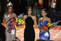 Former Miss Universe Paulina Vega, center, reacts before taking away the flowers, crown and sash from Miss Colombia Ariadna Gutierrez, left, and giving it to Miss Philippines Pia Alonzo Wurtzbach at the Miss Universe pageant on Dec. 20, 2015, in Las Vegas. (AP Photo/John Locher)