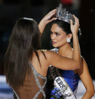 Miss Universe Paulina Vega, left, crows Miss Philippines Pia Alonzo Wurtzbach as the new Miss Universe at the Miss Universe pageant on Dec. 20, 2015, in Las Vegas. (AP Photo/John Locher)