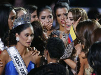 Other contestants comfort Miss Colombia Ariadna Gutierrez, top right, after she was incorrectly crowned Miss Universe at the Miss Universe pageant on Dec. 20, 2015, in Las Vegas. (AP Photo/John Locher)