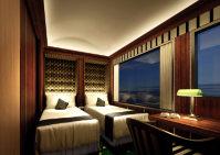 高級ホテルを思わせる落ち着いた内装の「瑞風」のツインルーム=JR西日本提供