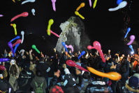 People celebrate the New Year, with the Saruiwa, or