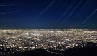 Stars streak the night sky over Sapporo in this image composed of 2,383 exposures taken from the summit of Mount Moiwa over about four hours. (Mainichi)