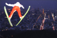 A ski jumper takes flight at Sapporo's Okurayama Jump Stadium. The lounge at the top of the run doubles as an observation point overlooking the center of the city. (Mainichi)