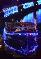 People are seen on a tour boat as it travels along the Otaru Canal in the city of Otaru, Hokkaido. (Mainichi)