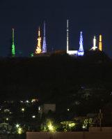 Broadcasting towers are seen illuminated atop Mount Sokuryo in Muroran, Hokkaido. (Mainichi)
