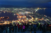 Visitors look out over the city of Hakodate, Hokkaido, from an observation point on Mount Hakodate. (Mainichi)