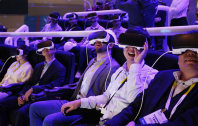 People react as they wear Samsung Gear VR goggles at CES International, on Jan. 6, 2016, in Las Vegas. (AP Photo/John Locher)