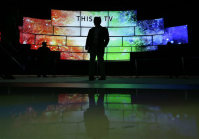 A man looks at Samsung SUHD TVs at CES International on Jan. 6, 2016, in Las Vegas. (AP Photo/Gregory Bull)