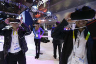 People wear Samsung Gear VR sets during a virtual reality demonstration at CES International Wednesday, Jan. 6, 2016, in Las Vegas. (AP Photo/Gregory Bull)