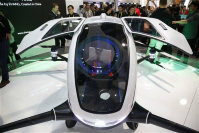 The EHang 184 autonomous aerial vehicle is unveiled at the EHang booth at CES International, on Jan. 6, 2016, in Las Vegas. The drone is large enough to fit a human passenger. (AP Photo/John Locher)