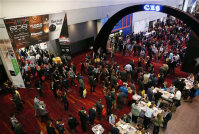 Crowds enter the show floor on the first day of CES International, on Jan. 6, 2016, in Las Vegas. (AP Photo/John Locher)