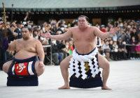 Yokozuna Hakuho, right, performs the