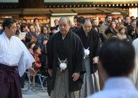 Japan Sumo Association Chairman Hakkaku, center, departs after the