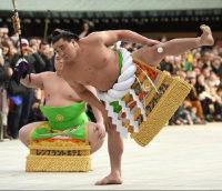 Yokozuna Harumafuji, right, performs the