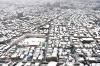雪に覆われた住宅街=東京都世田谷区で2016年1月18日午前8時15分、本社ヘリから喜屋武真之介撮影