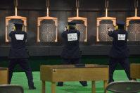 日ごろの射撃練習の成果を披露する警察官=甲斐市西八幡の県警察学校で
