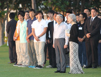 The Emperor (front, second from right) and Empress (front right) watch the sunset from the garden of a hotel overlooking Manila Bay with Japan Overseas Cooperation Volunteers in Pasay, in Metro Manila, on Jan. 26, 2016. (Pool photo)